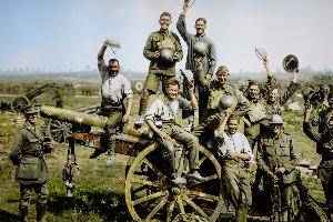 Young men cheering on captured gun