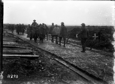 New Zealand troops move down a corduroy road near Gravenstafel, early on the morning of 4 October 1917, at the start of the New Zealand Division's involvement in the Third Ypres offensive.  Image courtesy of the Alexander Turnbull Library, Ref: 1/2-012938-G