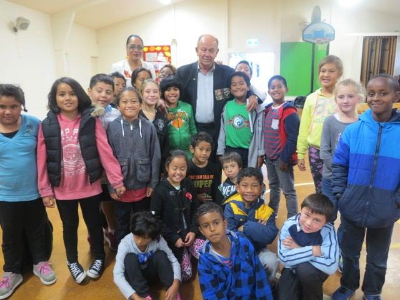 Graham Gibson surrounded by pupils from May Rd school