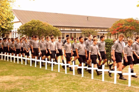 Palmerston North Boys walk through old boys crosses.