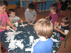 Pre-school children painting crosses
