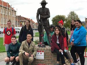 Students with the soldier statue at Messines